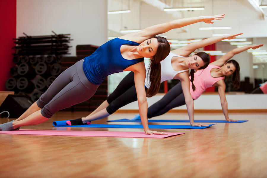Side Plank Yoga Pose By Three Women The Club Fitness